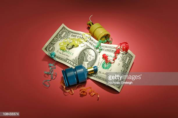US dollar banknote with party poppers