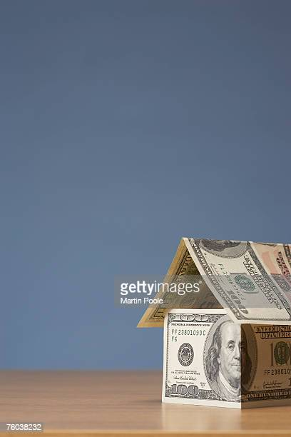 Dollar banknotes in shape of house