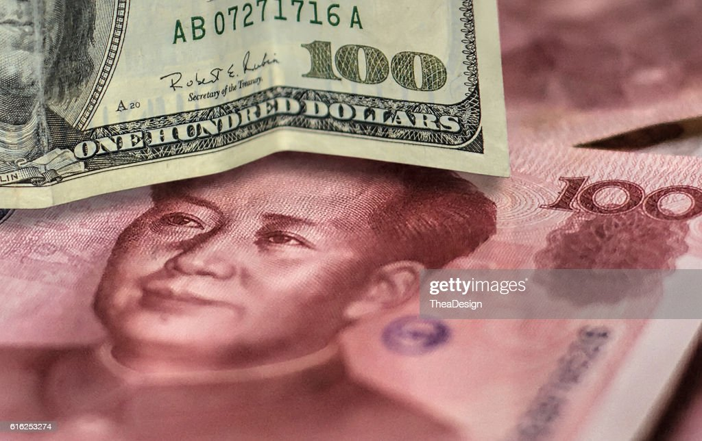 100 US dollar bill and 100 China yuan banknote. : Stock-Foto
