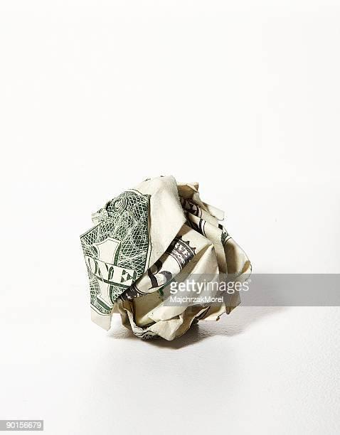 US dollar bill crumpled into a ball