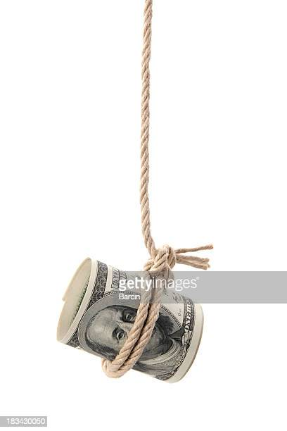 Dollar bill hanging by a string