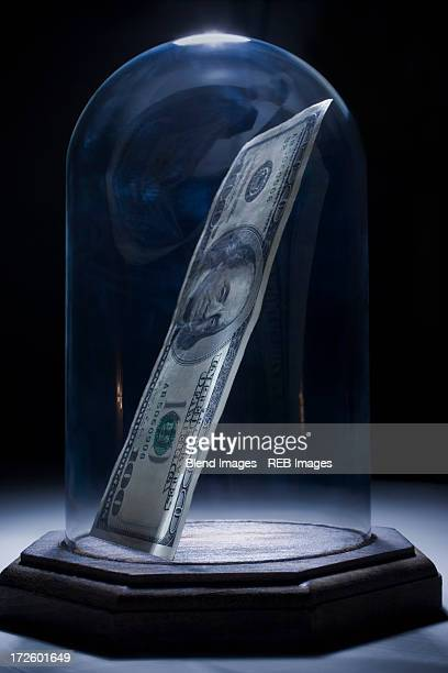 Dollar bill in bell jar
