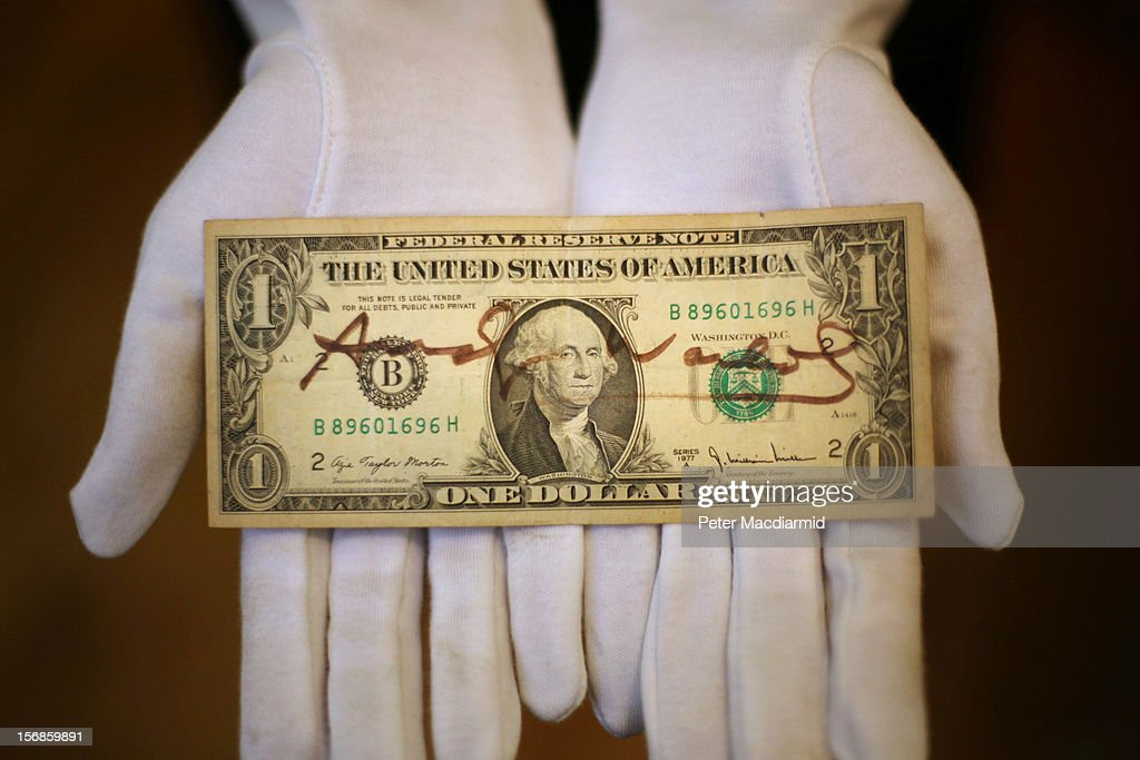 A US dollar bill signed by Andy Warhol is displayed at Christie's on November 23, 2012 in London, England. Estimated at £1000 - £1500 it forms part of Christie's Pop Culture sale on November 29 in London.