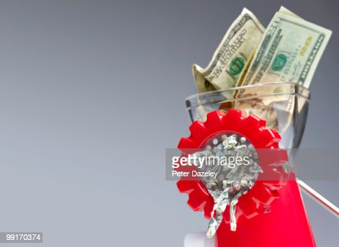 Dollar bills being minced destroyed  : Stock Photo