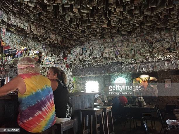Dollar bills drip from the ceiling and cover the walls at No Name Pub in Big Pine Key a good place to seek out for pizza conch fritters and the...
