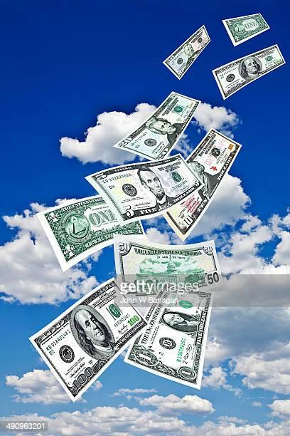 US dollar bills falling from sky