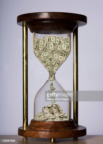 Dollar bills in a hourglass