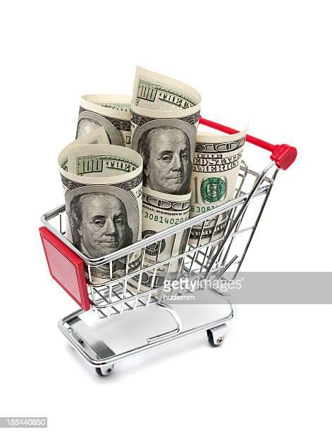 Dollarnoten in den Einkaufswagen