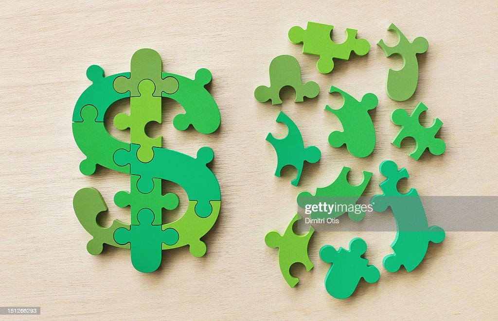 Dollar currency sign puzzle complete and in pieces : Stock Photo