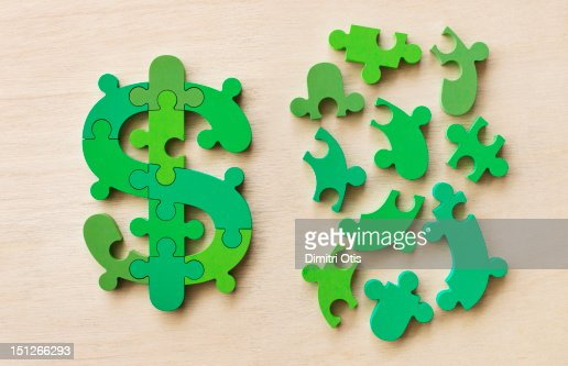 Dollar currency sign puzzle complete and in pieces : ストックフォト
