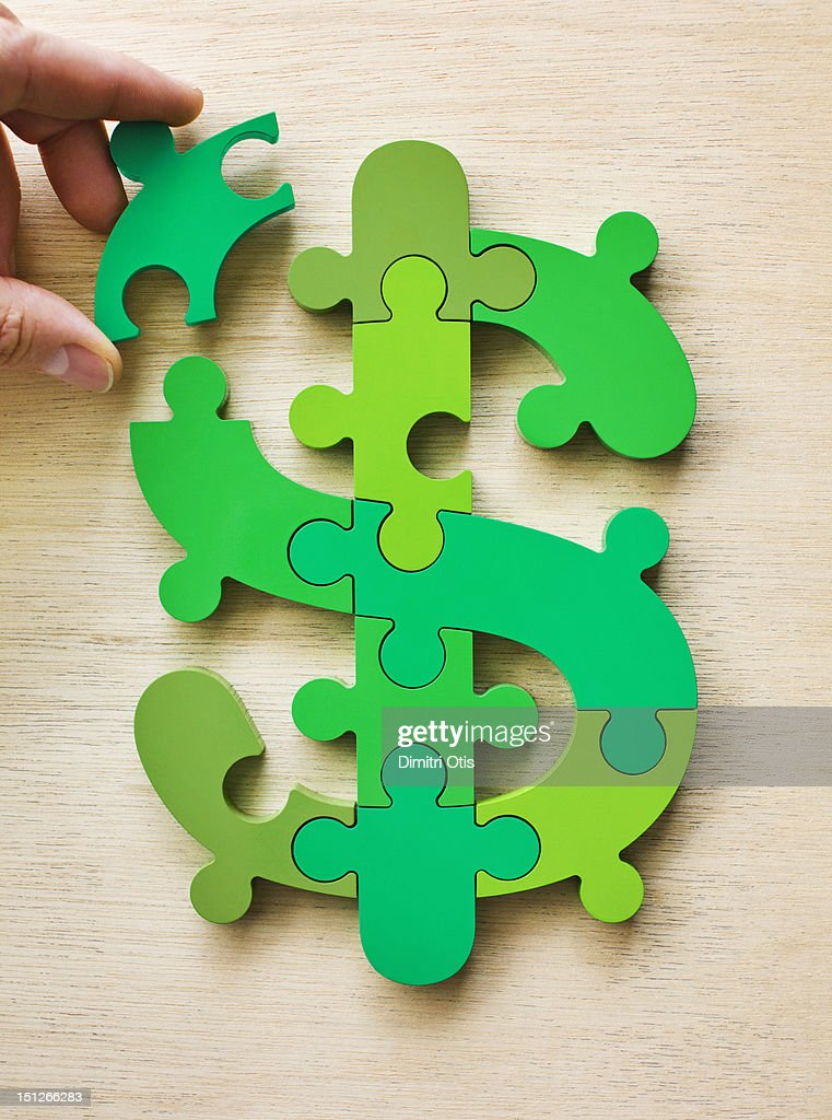 Dollar currency sign puzzle, last piece positioned : Stock Photo