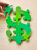 Dollar currency sign puzzle, last piece positioned