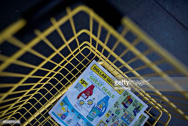 A Dollar General Corp circular sits in a shopping cart outside of a store in Rock Island Illinois US on Wednesday March 11 2015 Dollar General Corp...