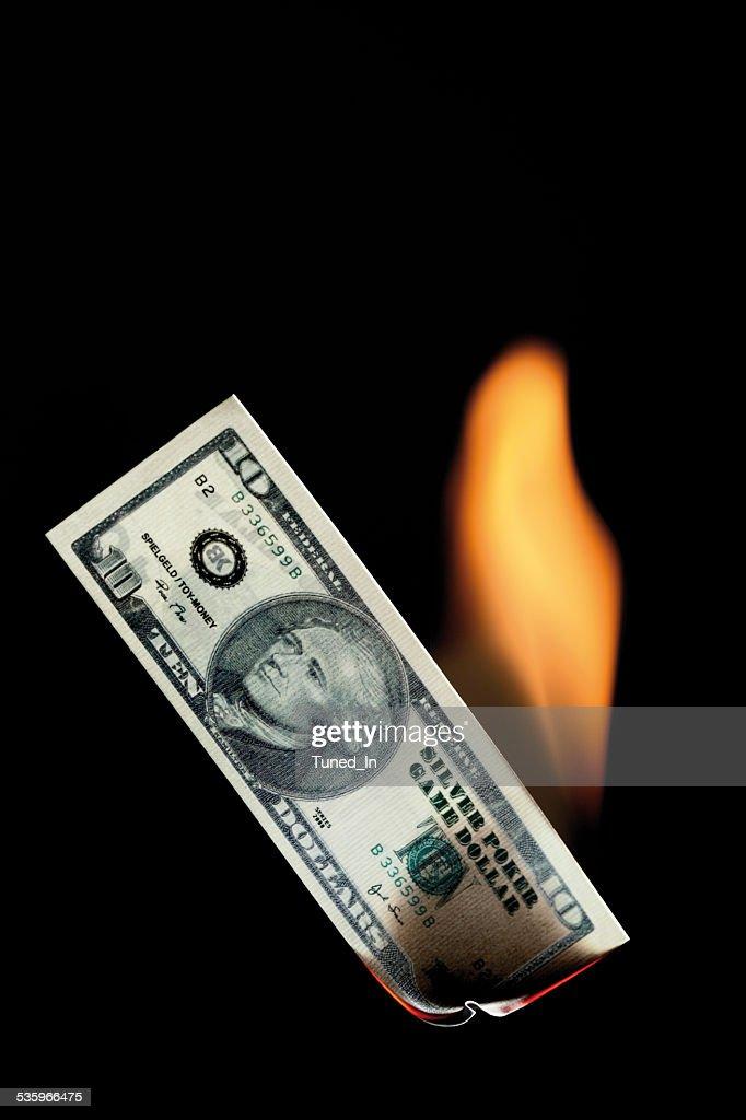 10 dollar note burning against black background : Stock Photo