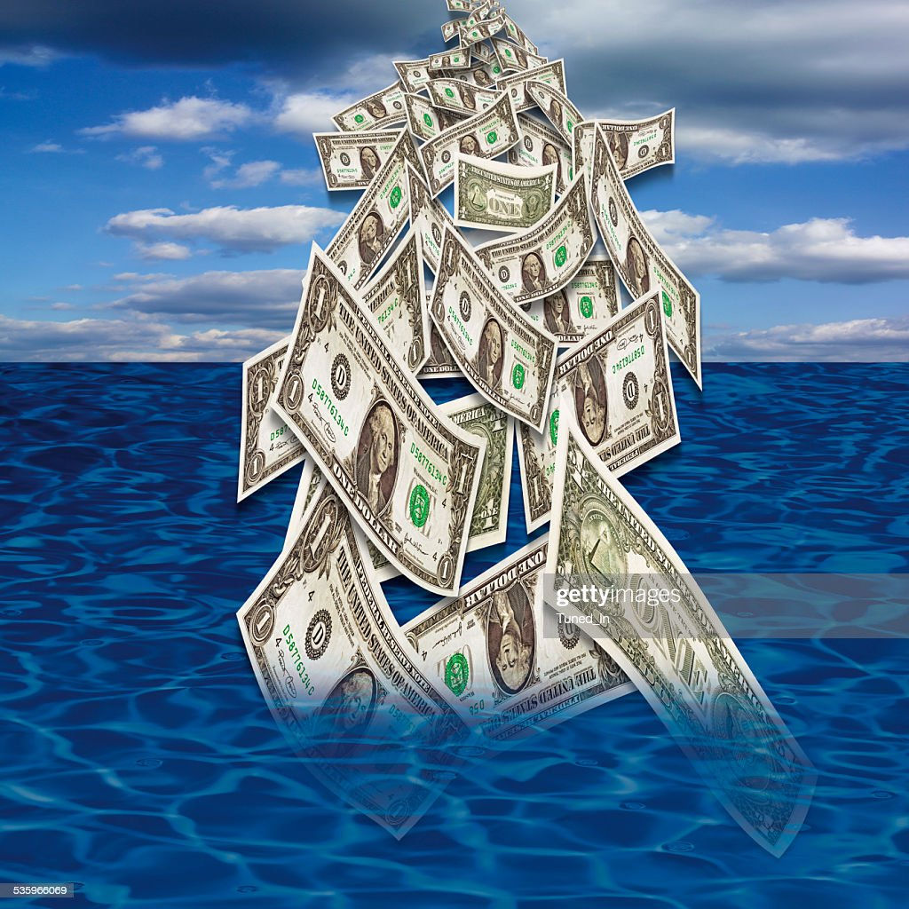 US dollar notes falling in sea from sky : Stock Photo
