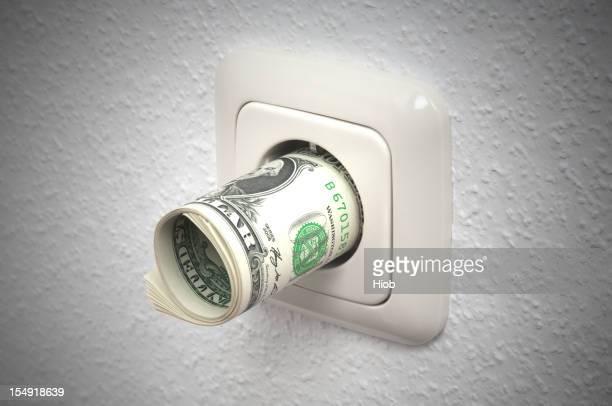 dollar notes in a power socket