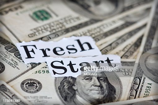 Dollar notes with fresh start text on top