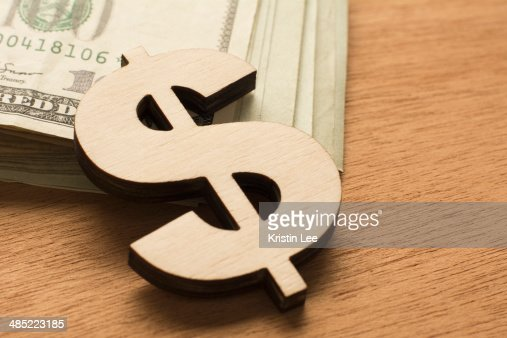 Dollar sign and cash