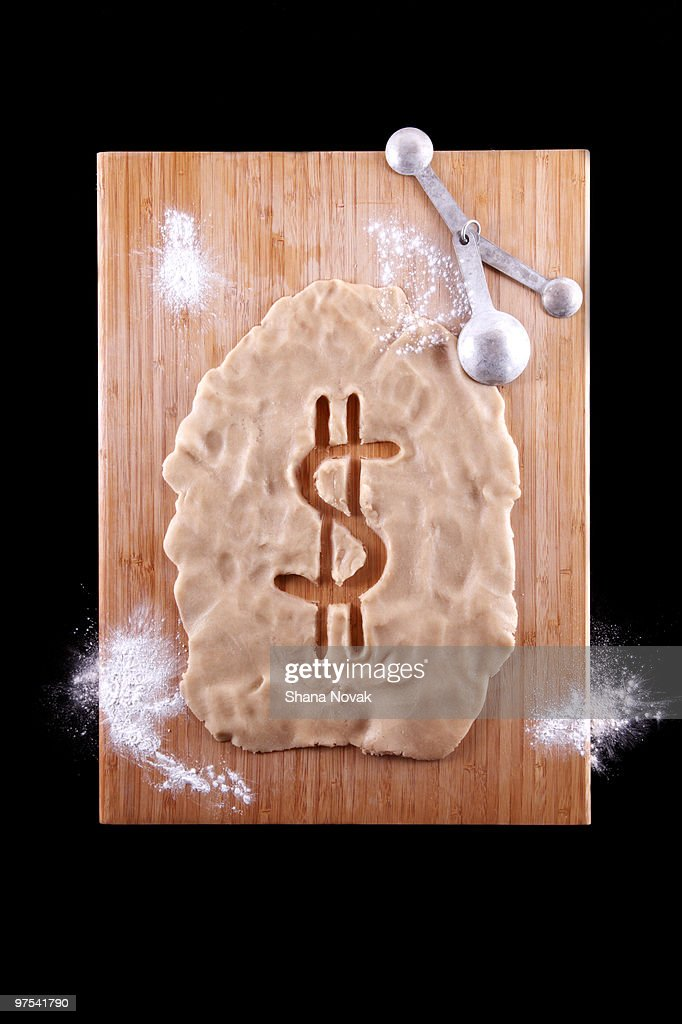 Dollar Sign Cut-Out of Dough : Stock Photo