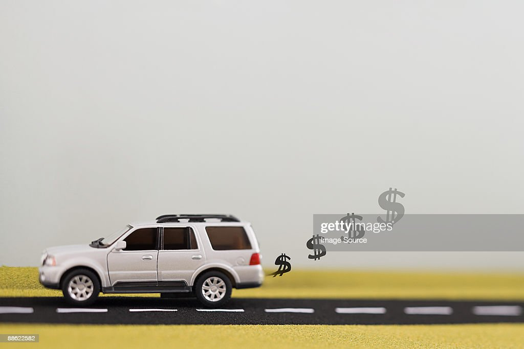 Dollar sign exhaust fumes : Stock Photo