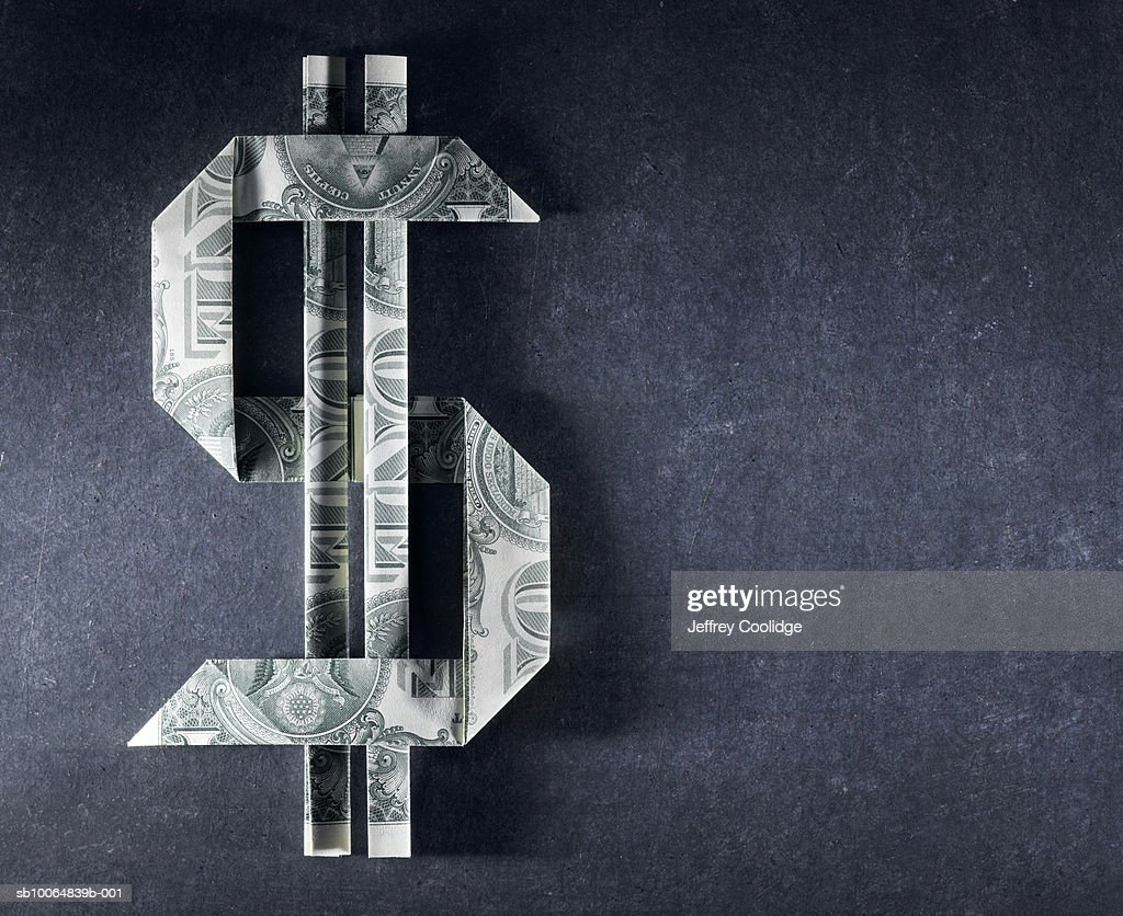 Dollar sign made from one dollar bills : Stock Photo