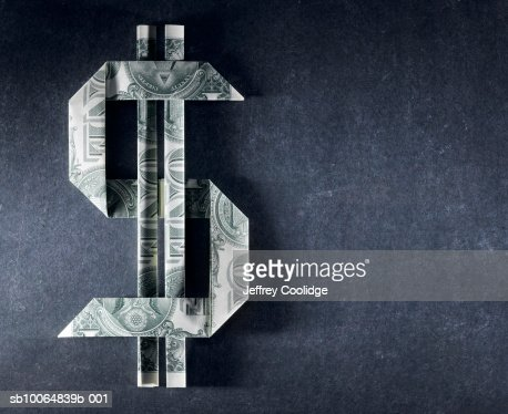 Dollar sign made from one dollar bills : Photo