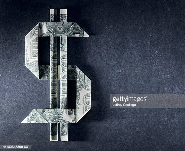 Dollar sign made from one dollar bills