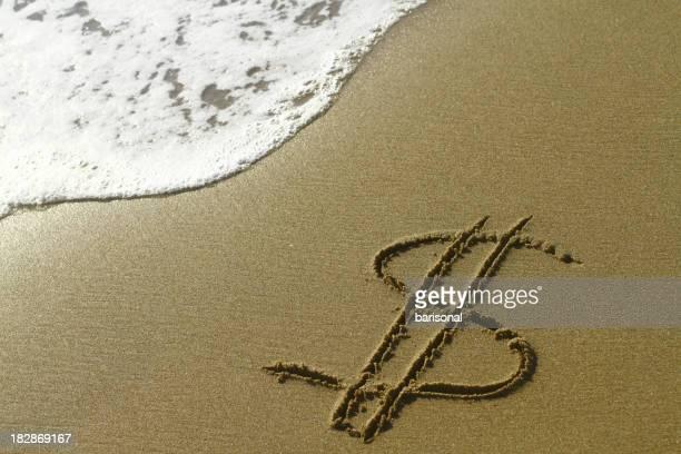 Dollar sign on the beach