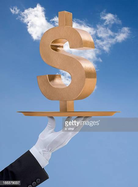 Symbole Dollar américain dépensé sur un plateau en or