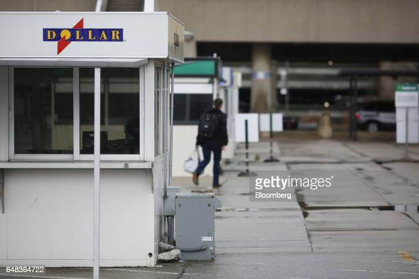 A Dollar Thrifty Automotive Group Inc rental booth stands inside the Louisville International Airport in Louisville Kentucky US on Tuesday Feb 28...