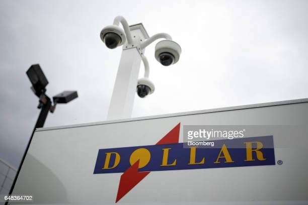 Dollar Thrifty Automotive Group Inc signage is displayed at a car rental location inside the Louisville International Airport in Louisville Kentucky...