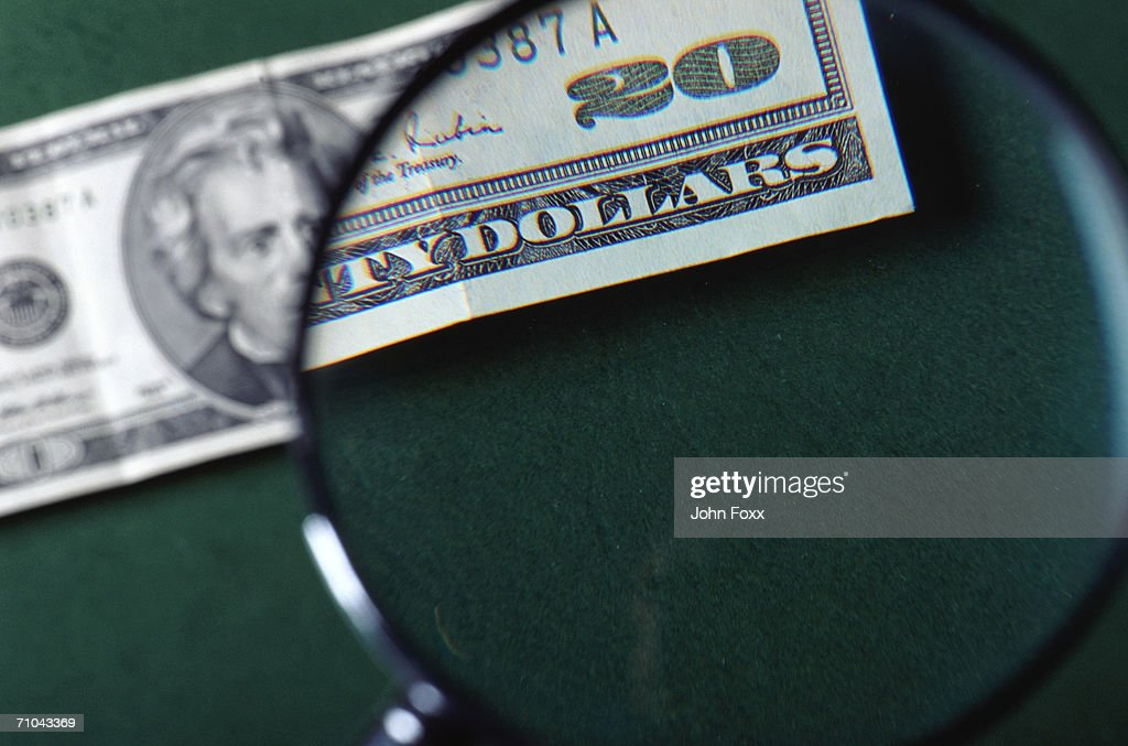 dollar-note with magnifying glass : Stock Photo
