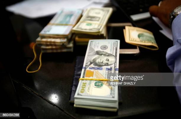 US dollars are seen at a foreign exchange dealer in central Khartoum on October 12 after the lifting of the US trade embargo came into effect Sudan's...