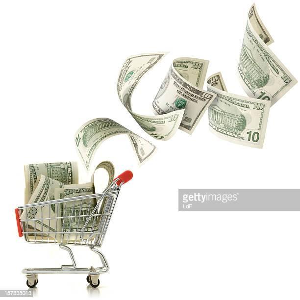 Dollar fallen in einen Einkaufswagen
