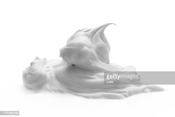 A dollop of cream on a white background