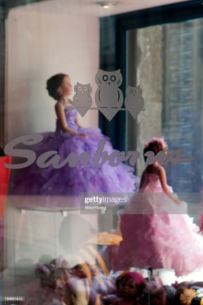 Dolls are displayed in a window at a Sanborns Grupo SAB store in Mexico City, Mexico, on Thursday, Feb. 7, 2013. Billionaire Carlos Slim is taking Mexican retailer Grupo Sanborns SAB public as revenue surges from sales to consumers looking to shop at its Saks Fifth Avenue stores and buy Apple Inc. iPads. Photographer: Susana Gonzalez/Bloomberg via Getty Images