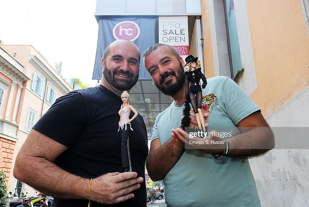 Dolls designers Alessandro Gatti and Giuseppe De Bellis attend the Madonna visit at 'The Hard Candy Fitness' at Colosseo on August 20, 2013 in Rome, Italy.