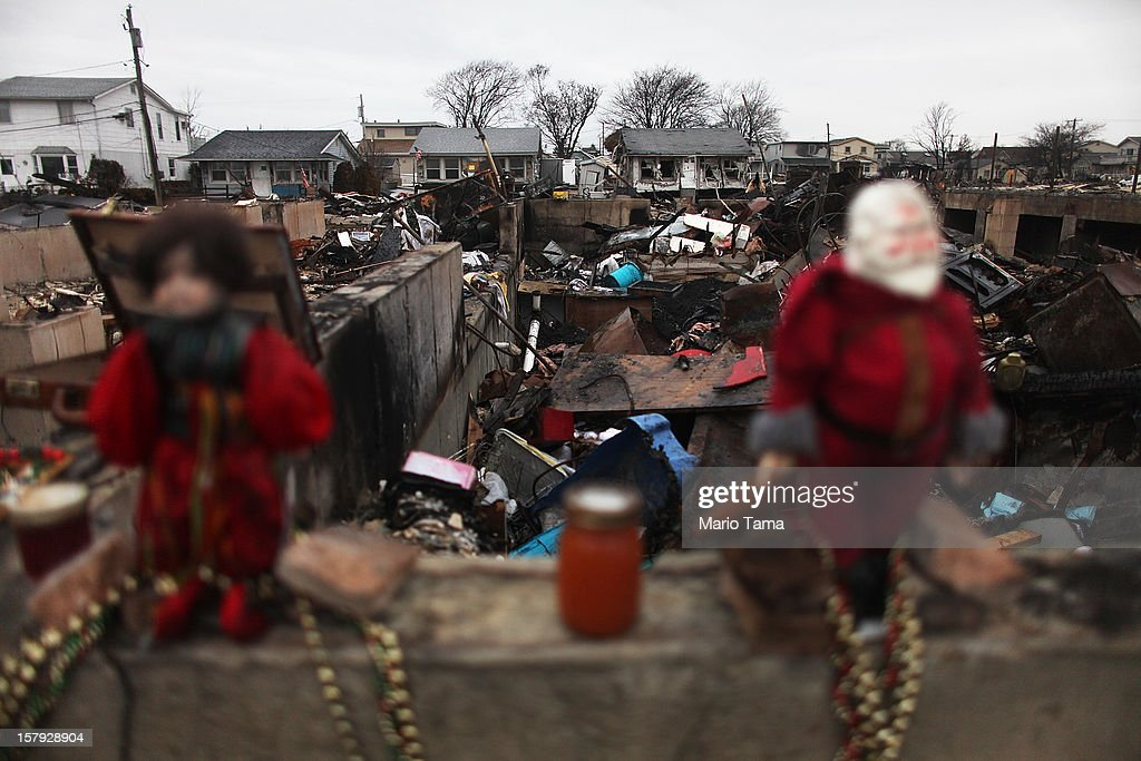 Dolls including a Santa Claus are perched on the remains of a destroyed home in the hard hit Breezy Point neighborhood on December 7, 2012 in the Queens borough of New York City. Breezy Point, home to many New York City firefighters and police, lost 111 homes in a fast moving fire during Superstorm Sandy with many more homes severely damaged from flooding.