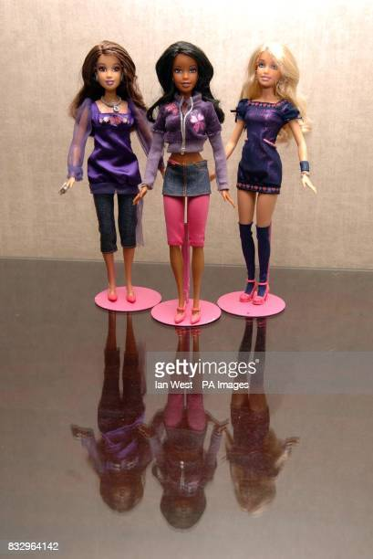 Dolls representing Amelle Berrabah Keisha Buchanan Heidi Range of the Sugababes pictured during a photocall to launch the collaboration with toy...