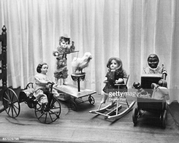 Dolls riding bicycles left performing clowns windup rocking chairs and baby dolls in buggies were among the earlyday toys Credit Denver Post