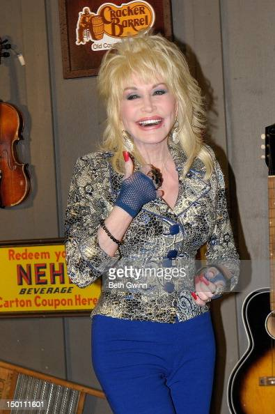 Dolly Parton gives a thumbs up at 'An Evening With Dolly' Gold Celebration at Dolly Records/CTK Management on August 10 2012 in Nashville Tennessee