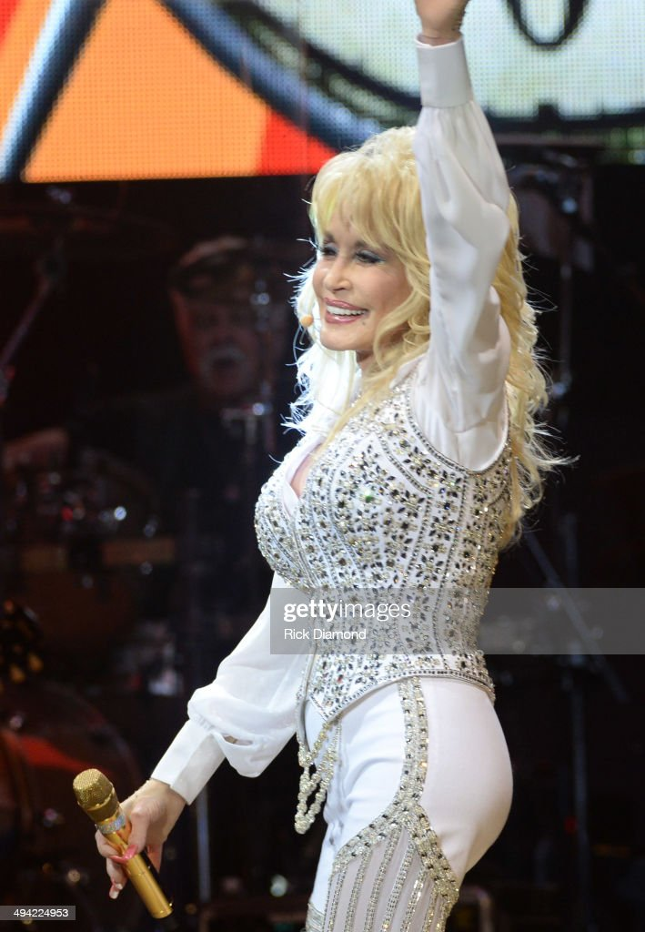 <a gi-track='captionPersonalityLinkClicked' href=/galleries/search?phrase=Dolly+Parton&family=editorial&specificpeople=220238 ng-click='$event.stopPropagation()'>Dolly Parton</a> performs during a concert to benefit Dolly's Imagination Library & Dr. Robert F. Thomas Foundation at The University of Tennessee's Thompson-boling Arena on May 28, 2014 in Knoxville, Tennessee.