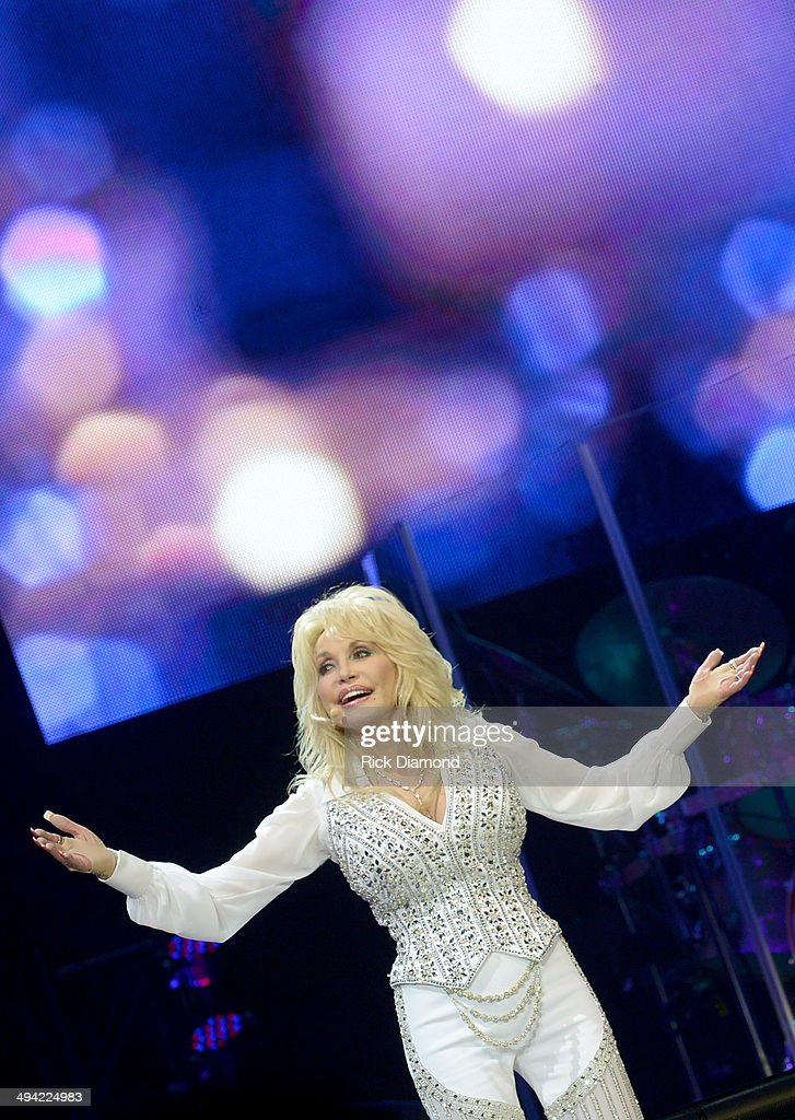Dolly Parton performs during a concert to benefit Dolly's Imagination Library & Dr. Robert F. Thomas Foundation at The University of Tennessee's Thompson-boling Arena on May 28, 2014 in Knoxville, Tennessee.