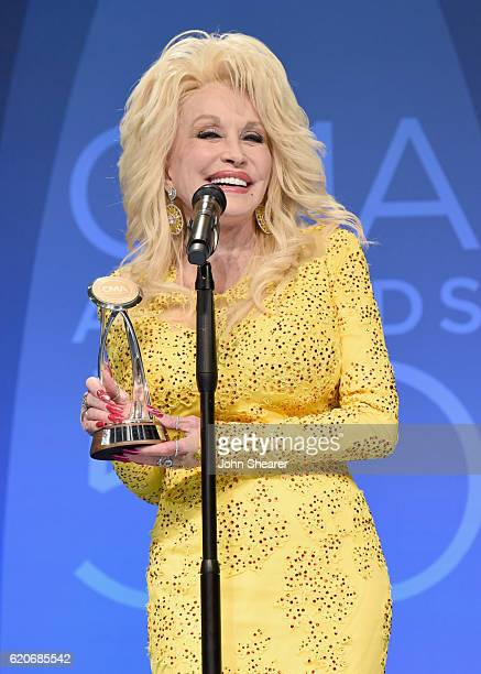 Dolly Parton poses with award backstage during the 50th annual CMA Awards at the Bridgestone Arena on November 2 2016 in Nashville Tennessee