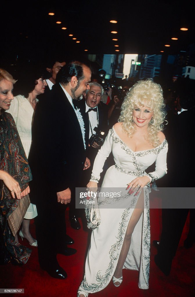 Dolly Parton wearing a white beaded dress at a formal event; circa 1970; New York.