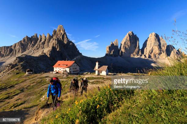 Dolomite, Italy : Group of trekking walk through the mountain in dre zinnia, Dolomite in the morning.