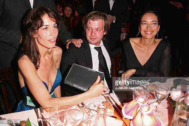 ACCESS *** Dolores Chaplin Jonathan Riss and Carmen Chaplin attend the auction of the Amfar inspiration night at Maxim's on June 25 2010 in Paris...