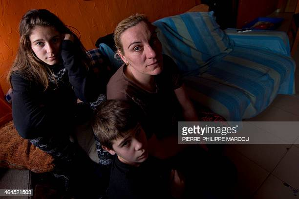 CUENCA Dolores Ferrer poses on her couch beside her daughter Nerea her son Cristian in Madrid on January 21 2014 For two years the life of Dolores...