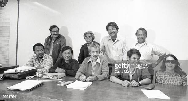 Dolores Huerta poses for a group portrait with the Board of Directors of the United Farm Workers group California ca1970s Standing left to right...