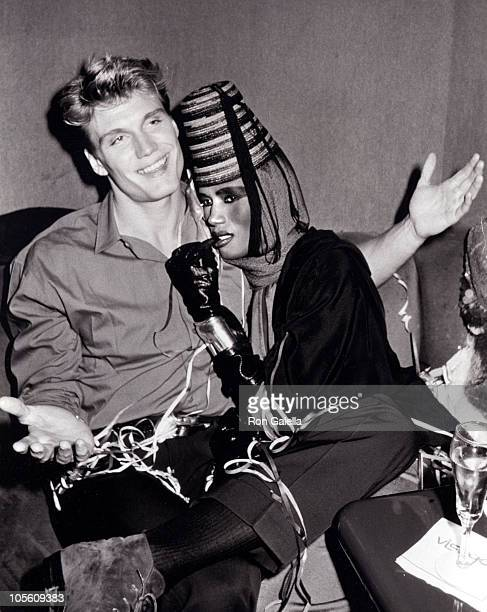 Dolph Lundgren and Grace Jones during Grace Jones' New Year's Eve Performance December 31 1985 at Visage Club in New York City New York United States